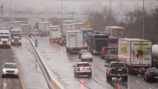Highway 465, northbound, near 71st street, after a night of freezing rain cased myriad slip-offs and crashes, Indianapolis, Saturday, December 17, 2016. Rain is expected throughout the day, with sub-freezing temperatures overnight compounding travel conditions.