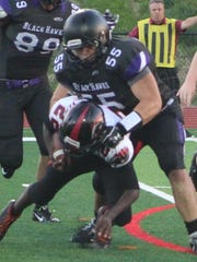 Senior Spencer Hasias, shown tackling a Troy player