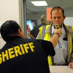 "A participant receives a breath sobriety test at the Cascade County Sheriff's Office as part of the department's ""24/7 Sobriety Program"" to curb DUIs in the county."