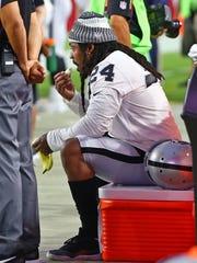 Raiders running back Marshawn Lynch sits on a cooler