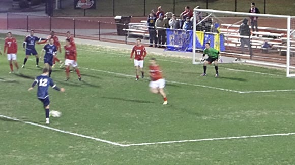 Indy Eleven's Ben Spencer (12) takes a shot against Louisville.