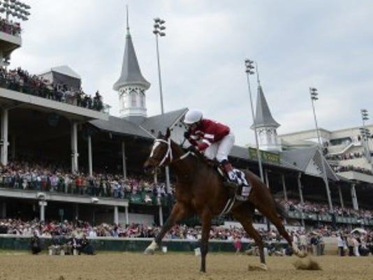 Untapable winning the Kentucky Oaks. Reed Palmer/Churchill Downs photo