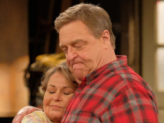 Roseanne (Roseanne Barr) and Dan (John Goodman) share a hug on ABC's 'Roseanne.'