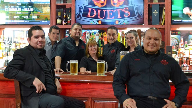 Owners and employees celebrated the grand opening Aug. 11 of Duets Bar & Grill in Central El Paso. Standing, left to right: Hugo Martinez, Adan Martinez, Barbara Cox, Jesse Jimenez, and Janet McPheron. Sitting, left, Jose Martinez, and Gerardo Escajeda.