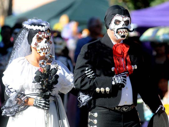 Members of the El Paso group Valle de Sol Grupo Folklorico donned bride and groom sugar skull masks while performing on the Mesilla Plaza during a recent Día de los Muertos celebration.