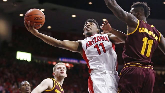Arizona guard Allonzo Trier looks to the basket with pressure from Arizona State's Savon Goodman against in Tucson, Ariz., on Wednesday, February 17, 2016.