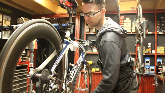 Matt Shapiola, service manager at Howell Bicycles, does some maintenance on a high-end bike at the shop.