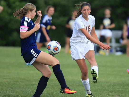 Plymouth Christian's Jessica Paulson (16) battles for