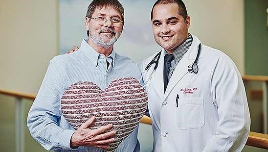 Frank Burns and Dr. Abhimanyu Uberoi, structural heart medical director with Kaiser Permanente Northwest.
