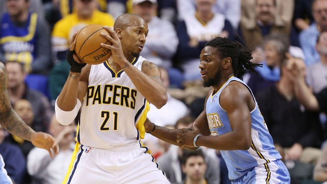Indiana Pacers forward David West (21) is guarded by Denver Nuggets forward Kenneth Faried (35) at Bankers Life Fieldhouse.