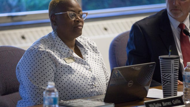 WaTasha Barnes Griffin sits with her fellow board members during the first meeting of the Ball State University appointed MCS school board on July 16 at the Muncie Area Career Center. The new members are planning to hold the monthly meetings at different locations through the year.