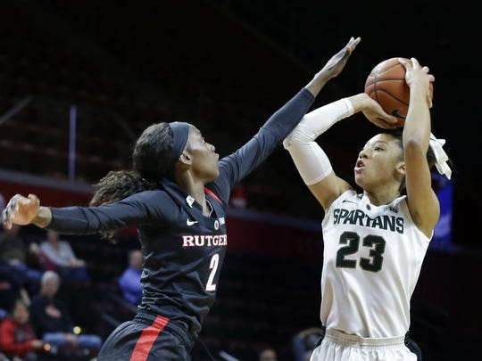 Michigan State forward Aerial Powers takes a shot past Rutgers forward Kahleah Copper during the first half of an NCAA college basketball game Thursday, Feb. 18, 2016, in Piscataway, N.J.