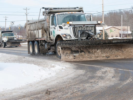 ODOT trucks salt and remove snow on Bridge Street in