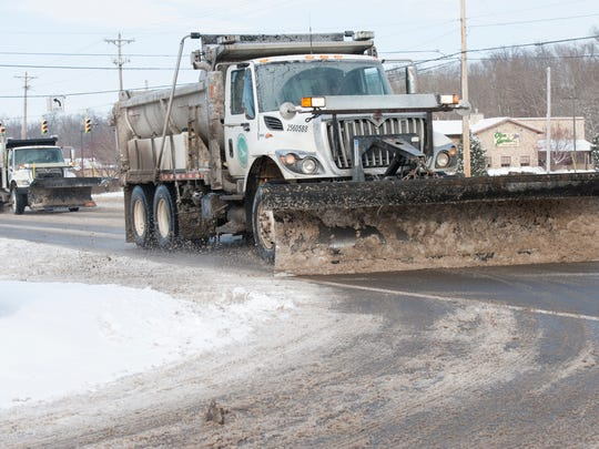 ODOT trucks salt and remove snow on Bridge Street in Chillicothe, Ohio, Tuesday afternoon after a long weekend of inclement weather effected driving conditions in the area.