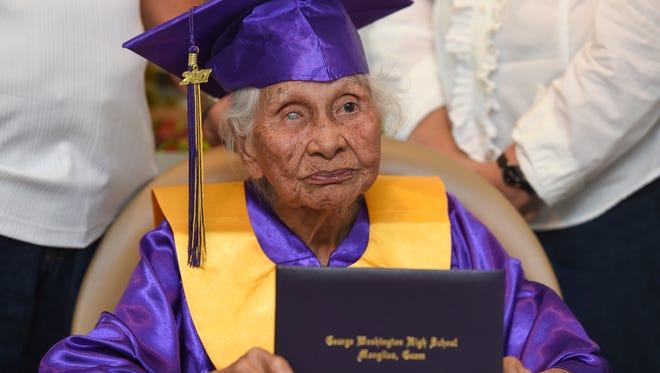 George Washington High School honorary graduate Maria Lizama Gumataotao, 95, with her diploma in Santa Rita on July 14, 2017.
