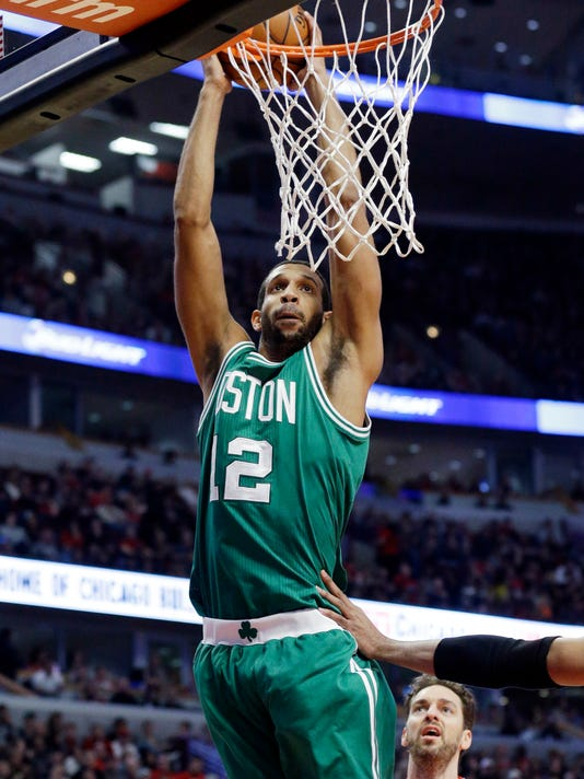 Boston Celtics center Brandan Wright (12) goes up for a dunk against the Chicago Bulls during the first half of an NBA basketball game in Chicago on Saturday, Jan. 3, 2015. (AP Photo/Nam Y. Huh)