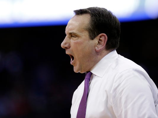 Duke head coach Mike Krzyzewski yells from the sidelines during the second half of a regional semifinal game against Syracuse in the NCAA men's college basketball tournament Friday, March 23, 2018, in Omaha, Neb. (AP Photo/Nati Harnik)