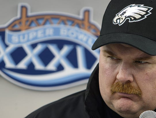 Philadelphia Eagles coach Andy Reid talks with reporters