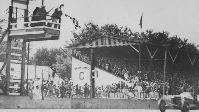 Louis Meyer takes the checkered flag in the 1936 Indianapolis 500 Mile Race.