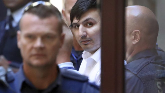 """James Gargasoulas, center, leaves the Victorian Supreme Court after sentencing, in Melbourne, Australia Friday, Feb. 22. 2019. The man who drove a stolen car into lunchtime crowds in downtown Melbourne and killed six people was sentenced to life imprisonment Friday in what the judge described as """"one of the worst examples of mass murder in Australian history."""""""