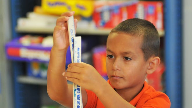 Joshua Vargas, 9, concentrates on a project. Behavior Education Center has recently moved from Cocoa to Rockledge, and now has more space for classrooms.