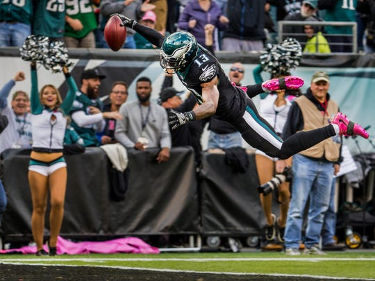 Philadelphia Eagles returner Josh Huff dives and flips into the end zone for a touchdown in the second quarter of the Eagles 21-10 win over the Vikings at Lincoln Financial Field in Philadelphia on Sunday afternoon.