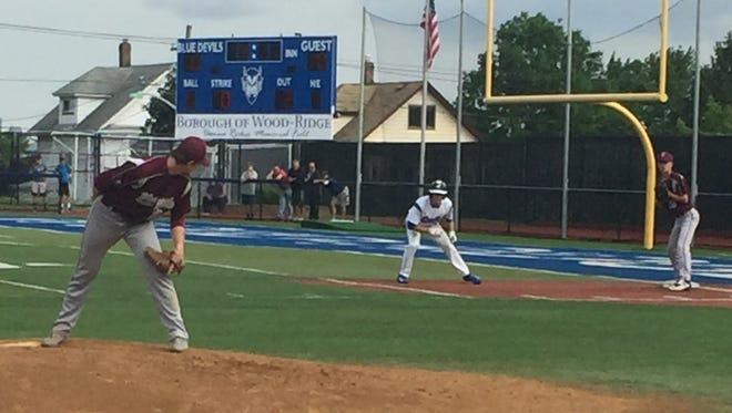Verona pitcher Collin Kiernan looks at a runner on first base against Wood-Ridge.