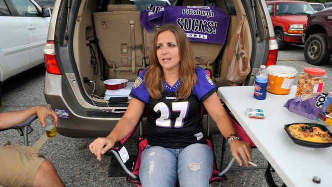 Holly Laucht, from Kent Island, Md., wears a Baltimore Ravens' Ray Rice jersey as she tailgates before the Ravens' NFL football game against the Pittsburgh Steelers on Thursday, Sept. 11, 2014, in Baltimore.