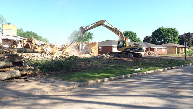 Houses are razed on Barberry Lane in Ashwaubenon in June 2015. Demolition of buildings lowered property taxes on about 30 percent of land the Packers own.