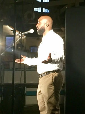 York College Professor Erec Smith told a story about racism in school at the York Storytellers Project 'School Days' event Sept. 21 at York's Central Market.