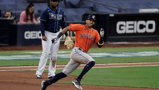 Houston Astros Carlos Correa runs to second after hitting a double against the Tampa Bay Rays during the seventh inning in Game 6 of a baseball American League Championship Series, Friday, Oct. 16, 2020, in San Diego.