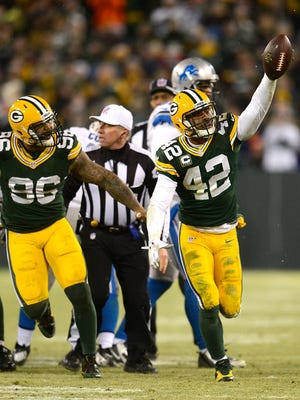 Green Bay Packers safety Morgan Burnett (42) raises the football after recovering a fumble in the fourth quarter during Sunday's game against the Detroit Lions at Lambeau Field.