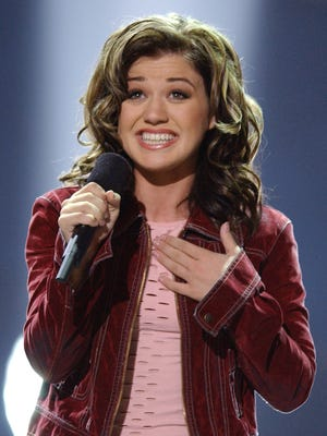 Kelly Clarkson, 20, of Burleson, Texas, sings 'A Moment Like This' after winning the first season in Los Angeles on Sept. 4, 2002.