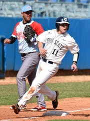 Penn State catcher Ryan Sloniger (11) rounds third base while watching Jordan Bowersox get thrown out at first to finish the inning at Latin American Stadium in Havana, Cuba on Wednesday.