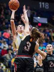 Northern Lebanon's Megan Brandt drives to the hoop against Gwynedd Mercy's Georgia Cattie to give Northern Lebanon a 40-38 lead as Northern Lebanon fell to Gwynedd Mercy Academy 43-42 in the PIAA 4A quarterfinals at Santander Arena in Reading, Pa. on  Sunday, March 19, 2017.