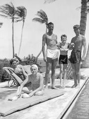In this October 1936 photo, John F. Kennedy, right, Robert F. Kennedy, second from right, and Patricia Kennedy, front left, pose with friends in Palm Beach, Fla.