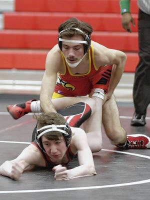 Christian Jodrey (back) and the Big Walnut wrestling team won the OCC-Capital Division championship to help the Golden Eagles capture the school's first Ralph Young All-Sports Award.