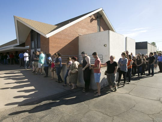 People wait in line to vote in the Arizona presidential-preference