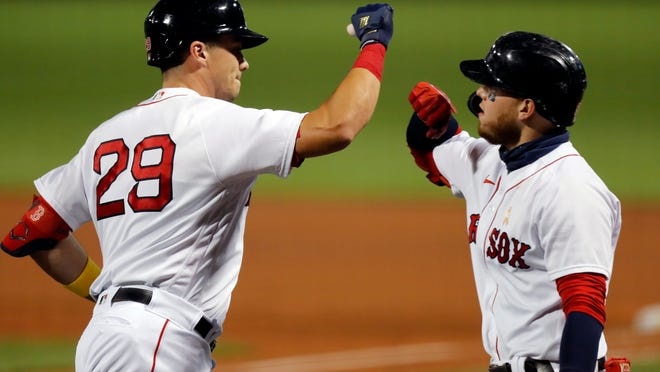 Boston's Bobby Dalbec celebrates his solo home run with Alex Verdugo during the second inning Saturday night.