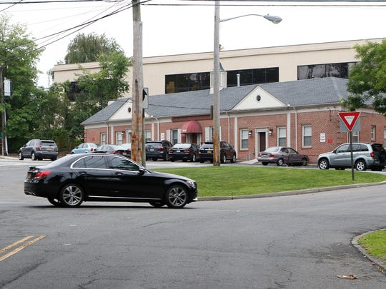 A car passes around the traffic island at the intersection of Hall, Vanderburgh and Palmer avenues in Larchmont.