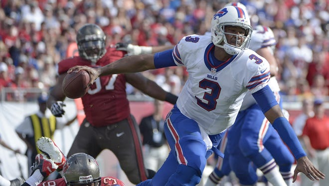 Buffalo Bills quarterback EJ Manuel is tripped up by Tampa Bay Buccaneers defensive tackle Gerald McCoy.