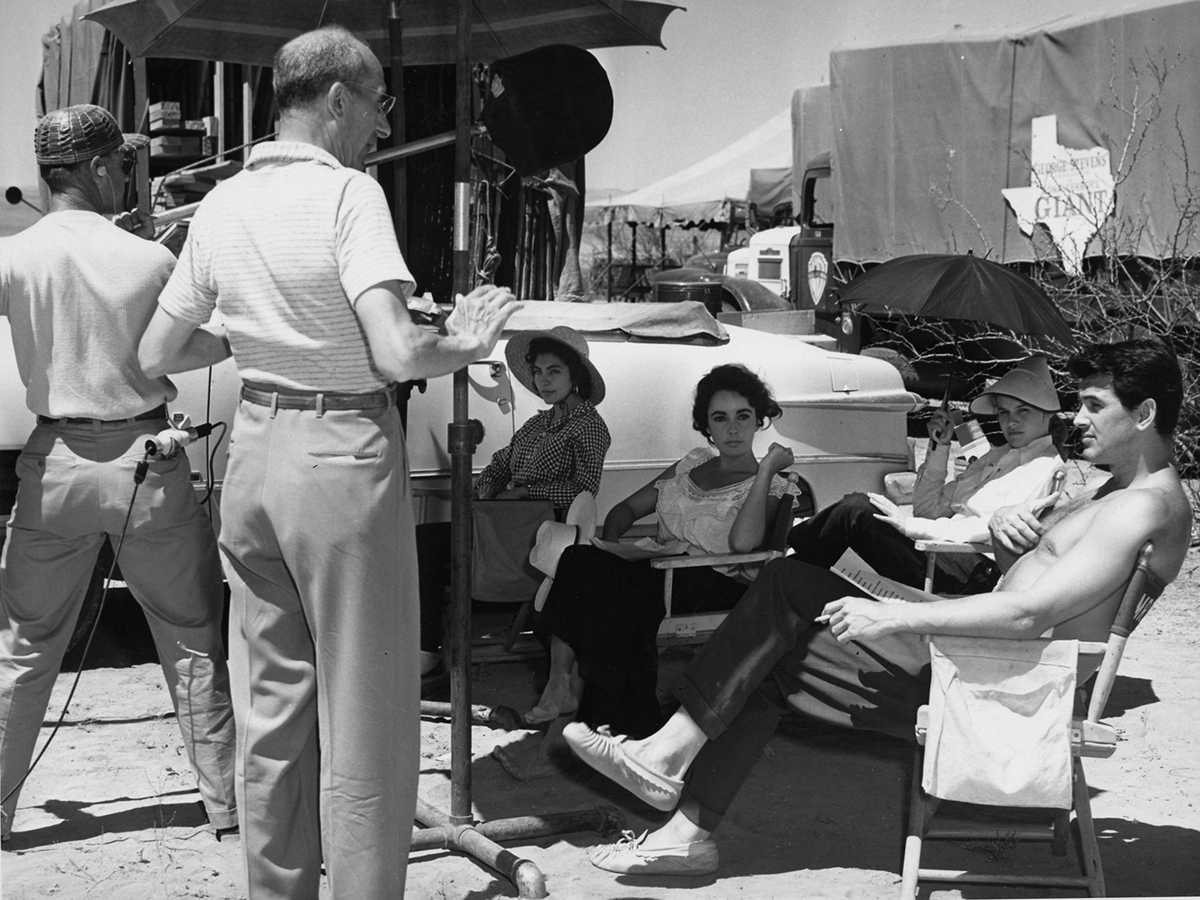 "Elsa Cárdenas, seated from left, Elizabeth Taylor, Carroll Baker and Rock Hudson Actors Elsa Cardenas, seated from left, Elizabeth Taylor, Carroll Baker and Rock Hudson relax between takes during the filming of ""Giant"" in Marfa, Texas, near El Paso. This year's Plaza Classic Film Fest with pay tribute to the film."