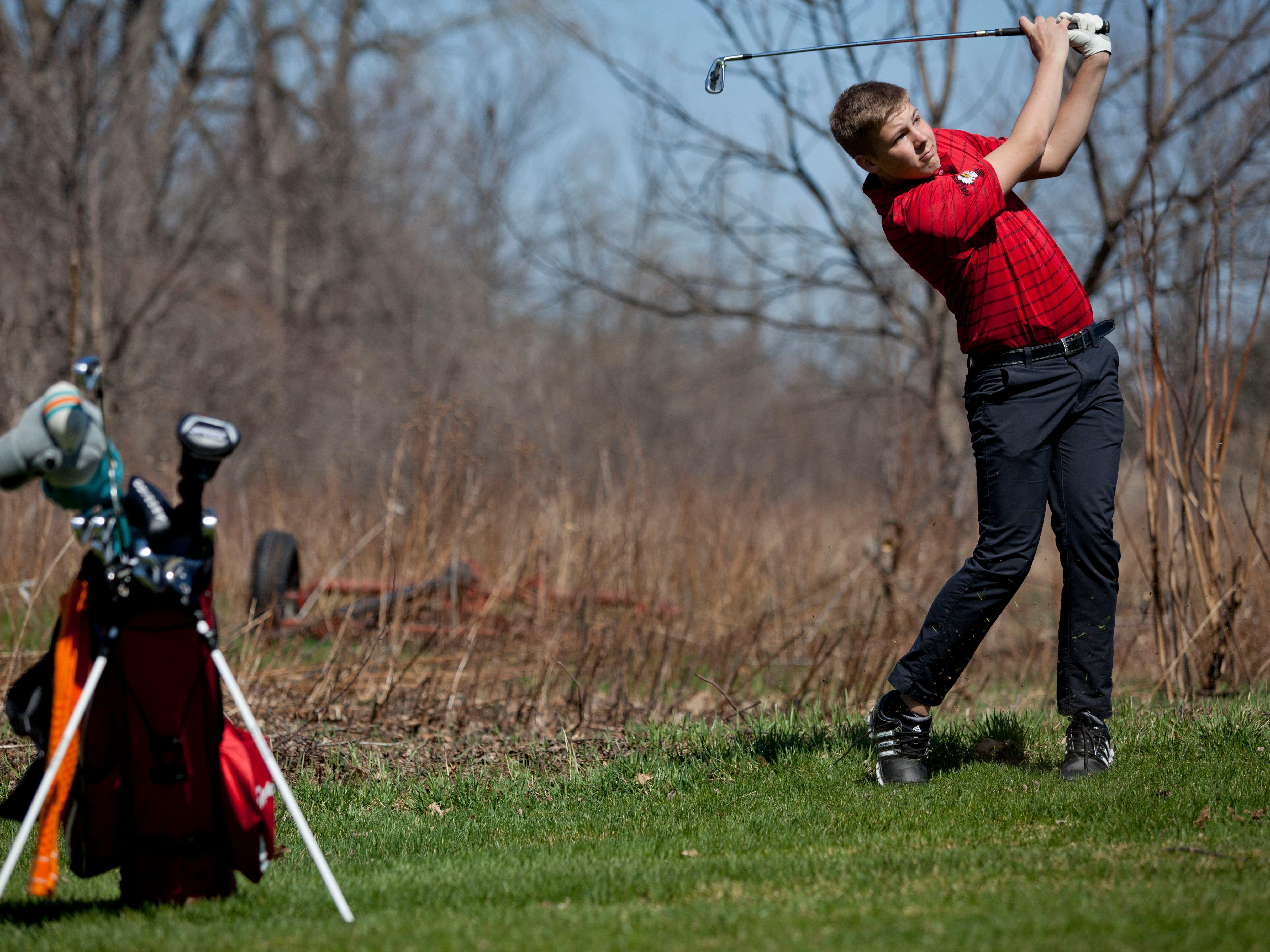 Port Huron freshman Nick Bailey, 14, takes a shot Friday, April 17, 2015 at the Port Huron Elks Golf Club in Port Huron Township.