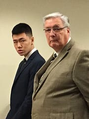 Rutgers student Daniel Bak stands next to his attorney Peter Weiner as he pleads guilty to drug charges in court Friday.