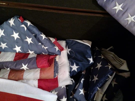 US flags are kept in a box at the Sykes Funeral Home