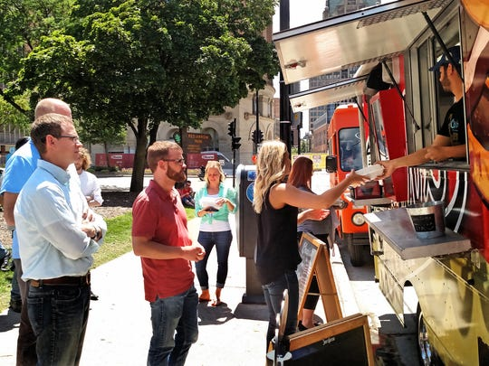 Red Arrow Park in downtown Milwaukee is crowded over the lunch hour on Fridays in the summer when local food trucks line up to serve hungry office workers and others along N. Water St. near City Hall.
