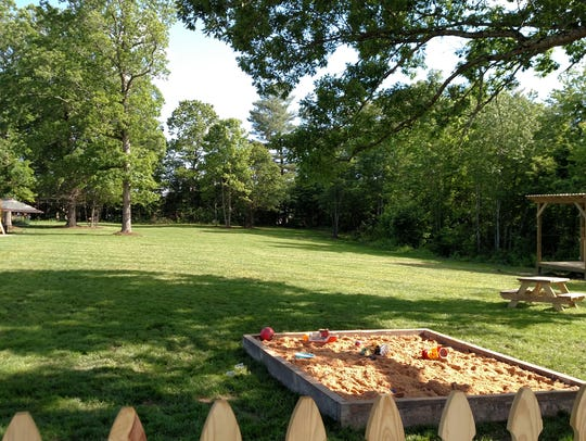 A sandbox and giant field at Blue Ghost Brewing in