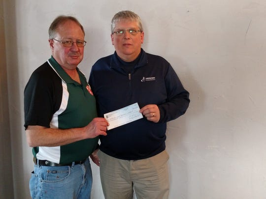 At a recent meeting of the Manitowoc County Tavern League, a check for $500 was presented to the Manitowoc Youth Baseball/Softball Association. Receiving the donation for the association was Randy Heinzen (right) from Tim Tomchek, president of the Manitowoc County Tavern League.