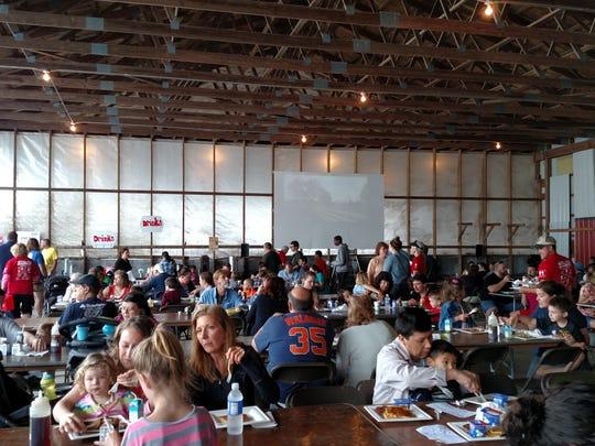 Participants enjoying breakfast at a past Breakfast