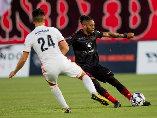 Phoenix Rising FC defender Amadou Dia drives the ball